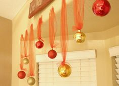 an idea for hanging decorations in our living room bay window or from the arch between the living and dining rooms