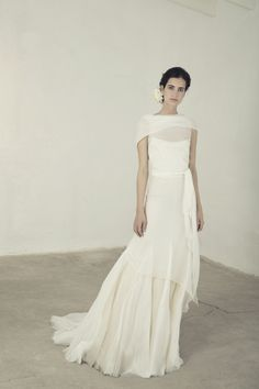 Cortana Wedding Dress. Mykonos dress, a silk bambula sleeveless dress with V neckline. The dress crosses over at the back and is tied at the waist. It has a overlapping skirt of the same fabric and organdy godets. It can be combined with the Liso or Nardo slip-dress. Made in Barcelona. Cortana Bridal Collection 2017. Shop now.