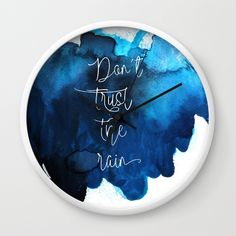 Don´t trust the rain wall clock by Maria Caballer Don´t trust the rain on @society #song #message #rain #water #watercolor #blue #typography #words #design #art #clock