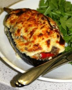 Moussake Stuffed Eggplant. Alter ingredients to make more healthy: use x virgin olive oil instead of butter  a small amount of low fat cheese