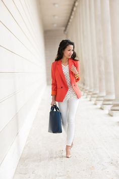 Coral Blazer, black/white top, white pants, and nude heels.