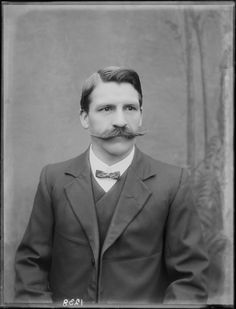 Unidentified man with handlebar moustache, wearing a suit with bow tie  [ca 1905-1926