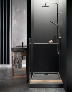 This dramatic black bathroom was completed by @baths2go . #luxeFL