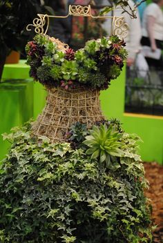A wrought iron dress forms gets transformed into a garden paradise.    We sell decorative dress forms at Mannequin Madness