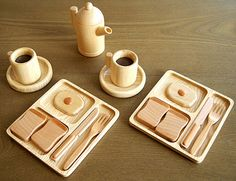 Stunning wooden toy breakfast set from Japanese wood craft shop Sasaki Kogei.  Entire set is a pricey $178 and pieces are also sold individually. They are a work of art!