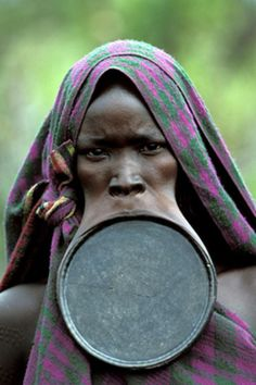 The Surna tribe  The Surna tribe of southern Sudan have very interesting physical features, form their teens the female go through lip stretching procedures by first removing their lower teeth to accommodate a lip plate, the lip plate is increased in size yearly until it is an astounding size, some of the men do similar things with their ears while the elongated lip plate gives them a fierce strange and frightening look.