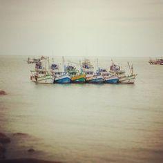 Few fisherman ships docket near the beach of Koh Samui