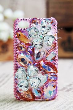 bling iPhone case, bling iPhone case, bling iPhone case :) LOVE the feathers!