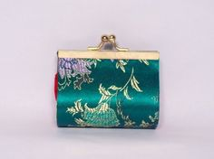 "Blossom Brocade Wallet or Make-Up Cases - Green (S) by ChinaExposure. $5.95. This unique, small-sized case allows you to put either change or make-up in. Designed with elegant blossom brocade in different background color.  Size 3.5"" x 3.3"""