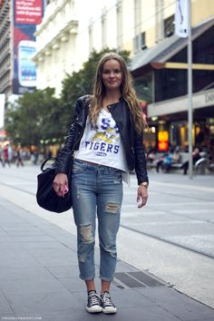 Cute sports inspired outfit // cutoff LSU tee, leather jacket, large bag, ripped and rolled up denim, and chucks!