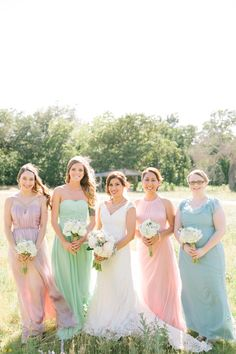 Different Color Dresses~ Photography: Bella Reese Photography - www.bellareesephotography.com  Read More: http://www.stylemepretty.com/2014/10/13/romantic-spring-wedding-on-a-budget/