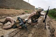 October 31, 2006: Marine Sgt. Jesse E. Leach drags a comrade shot by a sniper while patrolling in Garma