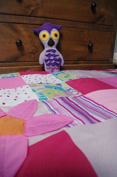 Pink flower playmat and olly owl