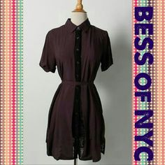 """BESS OF NYC * Retails for $1099 * NWT This is a fabulous designer piece. If you are looking for something unique that nobody else will have, than this is it! The photos do not do it justice! This shirt dress is a beautiful dark purple sheer rayon, layered with black lace.   Size on tag: M Shoulder to Shoulder: 15"""" Armpit to Armpit: 18"""" Waist: 19"""" Hip: 20"""" Sleeve Length: 8.5"""" Total Length: 34""""   Additional Details Closure type: Buttons Fabric content: 100% Rayon * Retails for $1099  This…"""