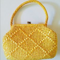 "Vintage Sunny Yellow Straw Purse This sweet Vintage sunny Yellow Straw Handbag is Made in Japan. Measures 8-1/2"" to top of kiss closure (6"" strap drop) x 12-1/2"" across x 3-1/2"" deep. Inside lined in a yellow wipeable plastic and has a small side pocket. In wonderful preowned vintage condition despite showing normal wear on kiss closure. All sides shown in pics. Smoke-free home. Vintage Bags"