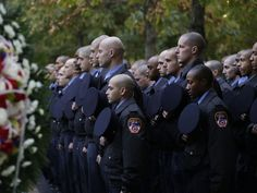 Probationary New York firefighters stand at attention at the Sept. 11 Memorial during a wreath laying ceremony in New York. The FDNYís 300 probationary firefighters participated in the ceremony to honor the fathers of two classmates who were killed in the attacks of Sept. 11, 2001.   Mark Lennihan, AP