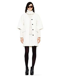 Crisp, white wool coat from Club Monaco is a beautiful contrast with black accessories.   #coat
