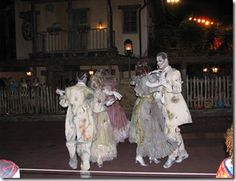 Waltzing ghost couples in Mickey's Boo To You Parade...