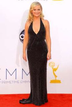 AMY POEHLER at the Emmys in L.A. (2012) | Yes, we're still sad that Poehler, and husband of nine years, Will Arnett are no longer an item. But you have to admit, Poehler has never looked better than when she arrived at the Emmys—just weeks after the split—in this sexy Stella McCartney number. (Frazer Harrison/Getty) | 2012 Emmy Awards