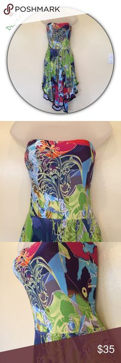 """Alberto Makali strapless floral dress size L Getting ready for Spring 🌷 A fun & flirty strapless rayon dress by Alberto Makali. A hi lo hem trimmed in faux black leather with lower side seams to prevent the skirt from bunching up or twisting around legs. 28"""" -36"""" chest very stretchy fits sort of like a tube top, 38"""" long top of dress to hem. In good condition. This dress is a very small large! Alberto Makali Dresses Midi"""