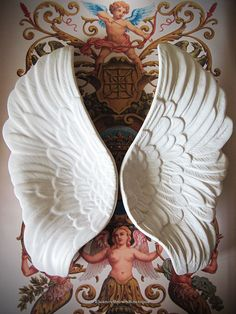 Pair of Ceramic Angel Wings -  Trinket Dishes - how awsome would these be to hang these on the wall in a nursery?