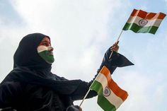 A girl waves Indian flags ' Tiranga' as she gears up for Independence Day celebrations in Ajmer, Rajasthan  #IDayonAIR