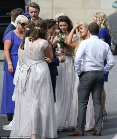 Bridal party: The brunette beauty - who just graduated from University - wore her locks in a voluminous half up-do while she highlighted her features with natural make-up OMG ELEANOR LOOKS AMAZING JUST MARRY HER LOUIS (sry if you dont ship elounor)