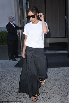 Falling flat: Victoria Beckham's concentration levels were undoubtedly waning on Friday when she was spotted leaving her New York hotel in a pair of flat strappy sandals paired with a pair of volumunious trousers and a white T-shirt
