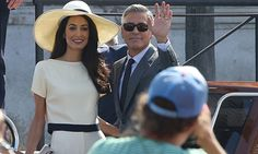 George Clooney and Amal Alamuddin wave for the camera as they leave Venice City Hall, Palazzo Ca' Farsetti, after their wedding on 29 September, 2014.