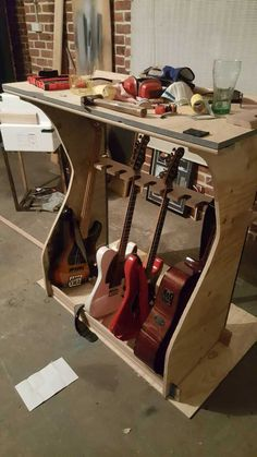Post with 804 views. Diy Guitar Stand, Wooden Guitar Stand, Guitar Display, Home Music Rooms, Music Studio Room, Guitar Wall Art, Guitar Room, Guitar Storage, Diy Workbench