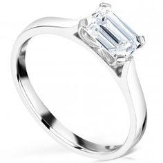 Modern, simple East-West set Emerald cut diamond engagement ring with four claw setting. Emerald Cut Diamond Engagement Ring, Emerald Cut Rings, Modern Engagement Rings, Diamond Solitaire Rings, Emerald Cut Diamonds, Diamond Jewelry, Diamond Cuts, Diamond Sizes, Wedding Ring Bands
