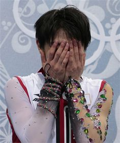 Yuzuru Hanyu of Japan reacts as he sits in the results area after the men's free skate figure skating final at the Iceberg Skating Palace at the 2014 Winter Olympics, Friday, Feb. 14, 2014, in Sochi, Russia. (AP Photo/Ivan Sekretarev) ▼14Feb2014 AP|Hanyu wins men's Olympic gold, Chan 2nd, Ten 3rd http://wintergames.ap.org/article/hanyu-wins-mens-olympic-gold-chan-2nd-ten-3rd #sochi2014 #figureskating #Hanyu #YuzuruHanyu