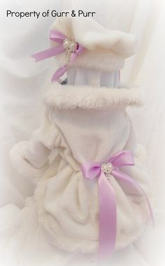 Toy Dog Coat/Dress with Matching Hat, in Winter White Faux Fur with Rhinestone and Lavender Satin Bow Accents. www.etsy.com/shop/GurrandPurr