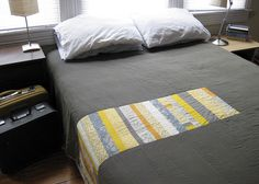 quilty goodness. I love that it has the quilty stuff and then is plain... good one to make for impatient crafters like me!!! A little bit of tricky then the rest plain - would be cool to make pillow cases with the stripy quilting too!!!