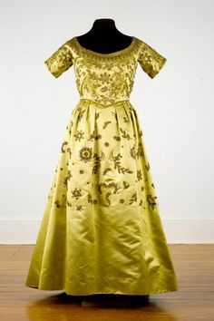 "Evening Gown, Hattie Carnegie (1889-1956), New York: 1955-1960, silk satin, metal, glass, sequins, metallic threads.     Label on center back seam: ""Hattie Carnegie Custom Made""    ""This gown was worn by Electra Havemeyer Webb at a 1953 debutante party for her granddaughter."""