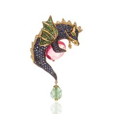 GREEDY BROOCH by KATHALINE PAGE-GUTH Hand-crafted in 18 karat yellow Gold, this whimsical GREEDY dragon brooch has been set with a Tourmaline cabochon, Sapphire, Tsavorite and Diamond pavé, and a single Chrysoprase briolette. Finished with a classic safety clasp.  www.kathalinepageguth.com