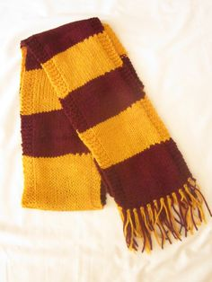 Harry Potter First Year Design Knit Scarf. This is a hand knit scarf in a knit and purl design. Made with Red Heart yarn, 100% acrylic. The