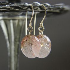 pink earrings with gold glitter and gold leaf on gold earwires - resin drop earrings. $21.00, via Etsy.