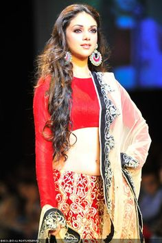 Bollywood actress Aditi Rao Hydari showcases a creation by designer Payal Singhal on Day 5 of the Lakme Fashion Week (LFW) Summer Resort 2013, held at Grand Hyatt, Mumbai, on March 25, 2013