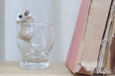 little mouse in glass.
