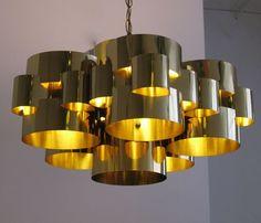 Cloud chandelier in brass by Curtis Jere'
