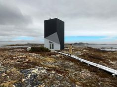Article source: Saunders Architecture The Tower Studio is dramatically situated on a stretch of rocky coastline in Shoal Bay, Fogo Island, Newfoundland. The studio's sculptural silhouette leans both forward and backward as it twists upward. Architecture Design, Amazing Architecture, Installation Architecture, Innovative Architecture, Building Architecture, House Cast, Hot House, Luz Natural, Building Design