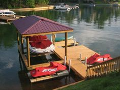 Simple boathouse with a deck and multiple jetski slips...