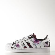 WANT THESE These women's adidas Superstar shoes are covered in a lush digital lotus print designed by Japanese graphic artist Shinpei Naito. Made in full grain leather with the iconic rubber shell toe, serrated 3-Stripes and cupsole.