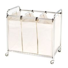 This Commercial-Grade Steel Frame Laundry Hamper Cart will keep your colors, whites and delicates separate. Each heavy duty draw string canvas bag can hold up to one load of laundry. Laundry Cart, Laundry Storage, Storage Bins, Laundry Organizer, Laundry Baskets, Clothes Storage, Floating Headboard, Sevilla, House
