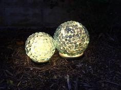 s 30 garden art ideas to fall in love with, Make Garden Globes With Marbles Easy A, Diy Garden Decor, Garden Art, Garden Crafts, Garden Projects, Diy Projects, Plant Projects, Garden Totems, Garden Junk