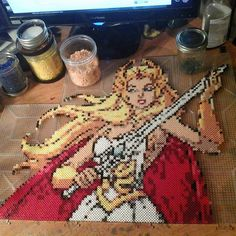 She-Ra Princess of Power. WIP commission done in perler and photo pearl beads. Will post final picture when it has been completed. She-Ra WIP Fuse Beads, Hama Beads, Cartoon Network, Geek Perler, 8bit Art, Peler Beads, She Ra Princess Of Power, Perler Bead Art, Perler Patterns
