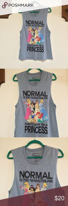 """Disney Princess Tank Top Adorable great condition!! """"Normal is too mainstream that's why I'm a princess"""" Disney tank top!! Size XL. 19.5"""" armpit to armpit (laying flat), 28"""" shoulder to hem, 13"""" arm hole. 84% Polyester, 16% Cotton. Disney Tops Tank Tops"""