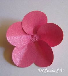 Paper flowers on Handmade Photoframe -- balloon punch for petals