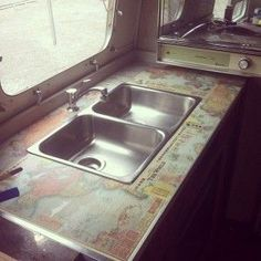 DIY Map Countertops in our vintage  Airstream Land Yacht camper